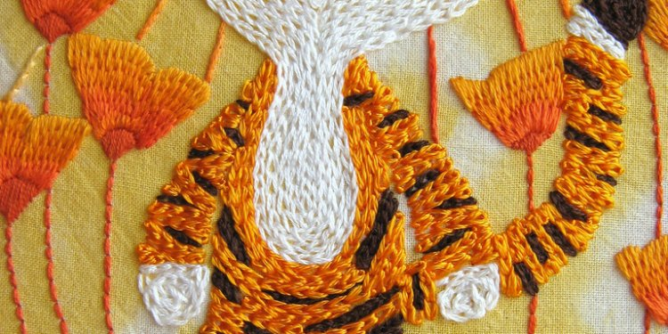 Little Tigers Orangey Celebration embroidery close-up